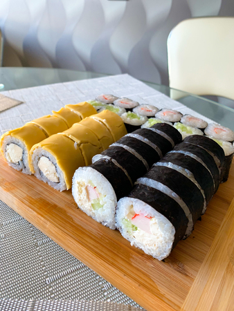 Japanese sushi set. Set of sushi rolls delivered home ready to eat fast healthy food