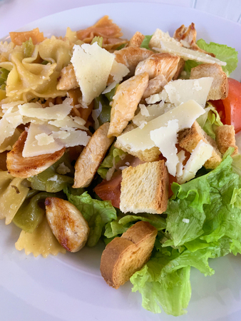 Caesar salad with chicken, mozzarella and cherry tomatoes