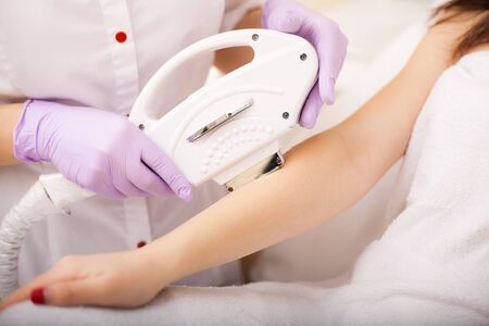 Skin care. Hands Laser epilation and cosmetology. Hair removal cosmetology procedure 版權商用圖片