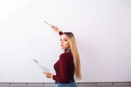 Portrait Of Happy Young Businesswoman woman near on white wall