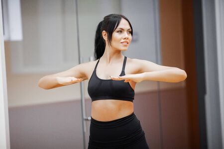 Healthy lifestyle. Fitness woman doing exercise in gym 写真素材