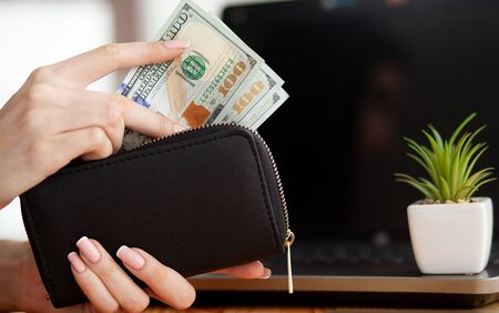 Woman With Money at Workplace. Business Concept.