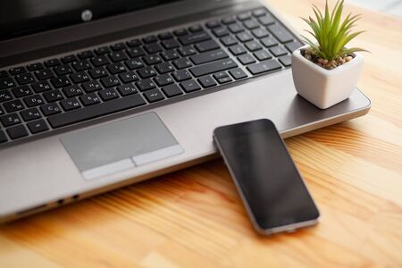 Desk with various gadgets and office supplies. Stock Photo