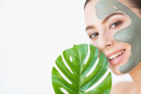 Beauty face skin care. Woman with cosmetic spa facial mask