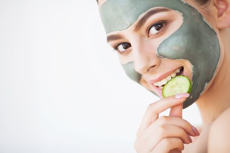 Beauty face skin care. Woman with cosmetic spa facial mask Foto de archivo