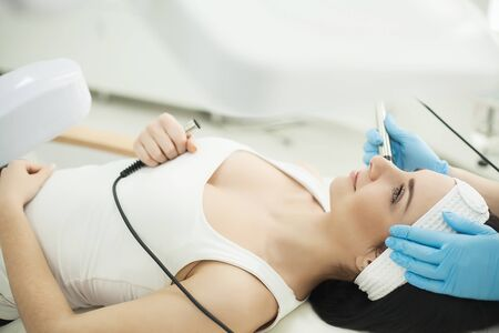 Body Care. Woman Receiving Face Skin Analysis. Cosmetology Stock Photo