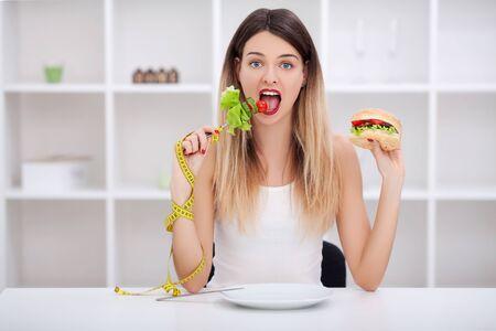 Choose between junk food versus healthy diet Stock fotó