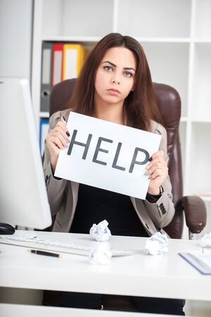 European tired and frustrated woman working as secretary in stress at work business district office desk with computer laptop asking for help in frustration concept