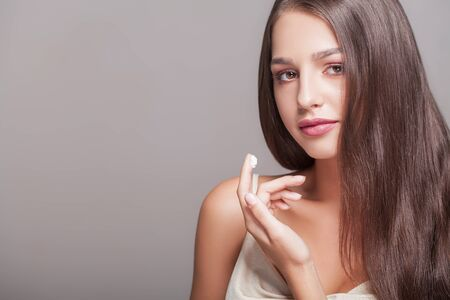 Close-up of a Young Woman Getting Spa Treatment. Cosmetic Cream on a Cheek. Skin Care Stock Photo