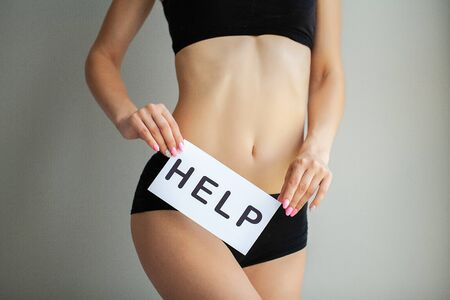 Woman Health Problem. Closeup Of Female With Fit Slim Body In Panties Holding White Card With Word Help Near Her Stomach. Digestive Disorders, Period Pain, Health Issues Concept
