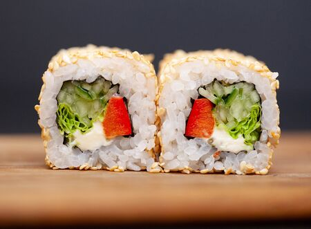 Sushi roll with salmon, cheese and cucumb Stock fotó