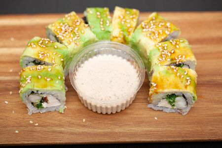 Sushi roll with salmon, cheese and avocado. Stock Photo