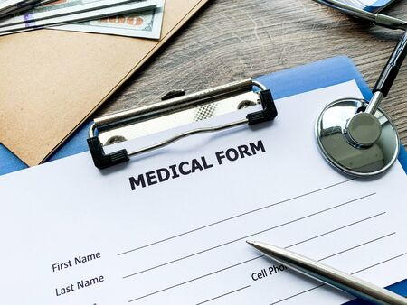 Medical form with patient data on doctors desk