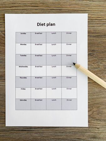Health concept. Diet plan on wooden background Stock Photo