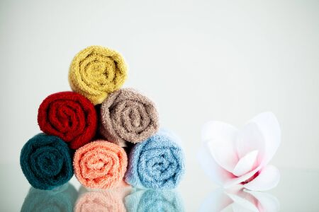 Colored towels on white table with copy space on bath room background Banque d'images