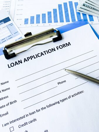 Loan application form document with graph on table Stock fotó