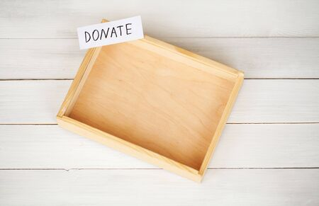 Donations and Charity. Donation Concept. A Donation Box on the White Background. Inscription Donate