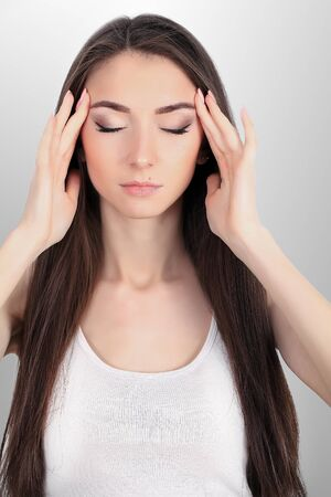 Young sad woman touch forehead and feel strong head ache