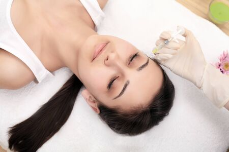 Woman Having Injection In Lips As Beauty Treatment