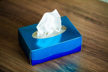 Box hygiene napkins on the brown desk