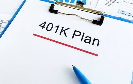 Paper with 401k plan on wood table