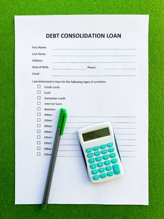 Debt consolidation loan document with graph on table Stockfoto - 130410541