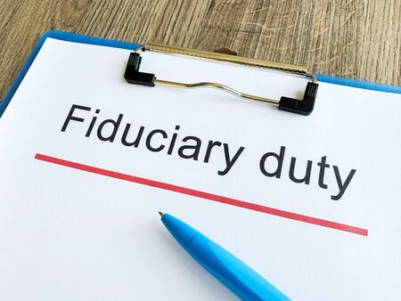 Paper with text fiduciary duty on wood table