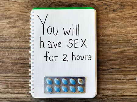 Pills for mens health and notepad with text.
