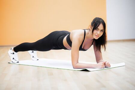 Healthy Lifestyle. Fitness woman doing exercises in gym.