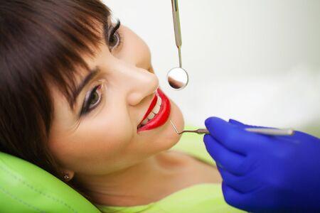 Dental care. Woman treats teeth in dental clinic.