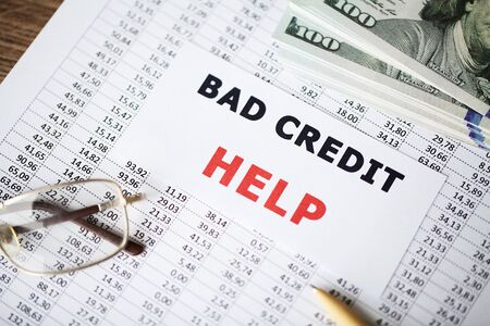 Credit concept. Bad credit written on white card.