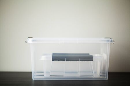 Transparent drawers for storing things on a wooden table Banco de Imagens