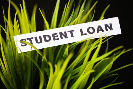 Credit concept. Student loan written on white card.