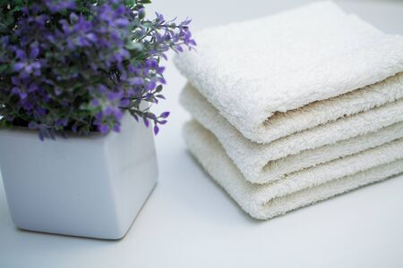 White towels on white table in bath room background.