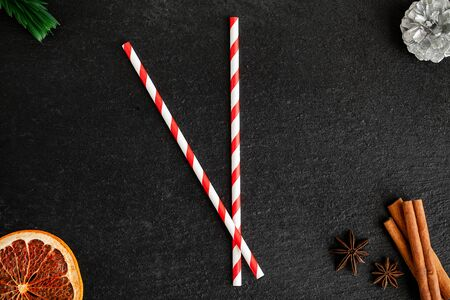 Tubes arrows simulate a clock on a Christmas background
