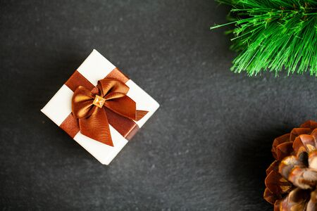 New year gift with christmas decorations on dark background Reklamní fotografie