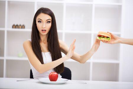 Choose between junk food versus healthy diet Reklamní fotografie