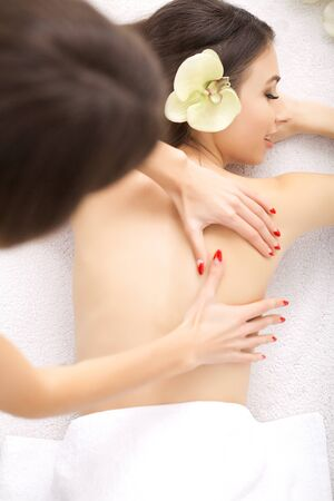 Spa. Woman on healthy massage of body in the spa salon.