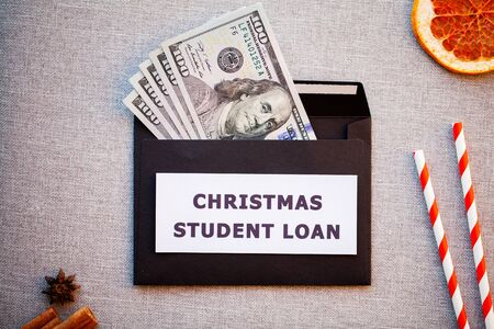 Student loan in a black envelope on a Christmas background