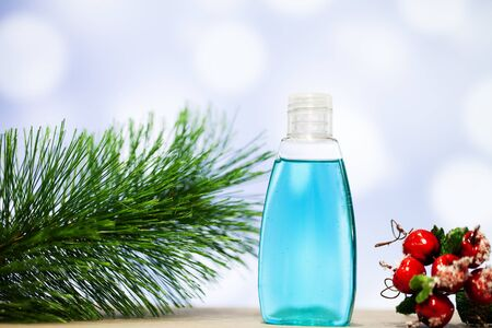 Christmas decoration and spa accessories on blue background.