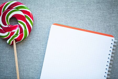 Red Christmas Candy Canes with blank on gray background