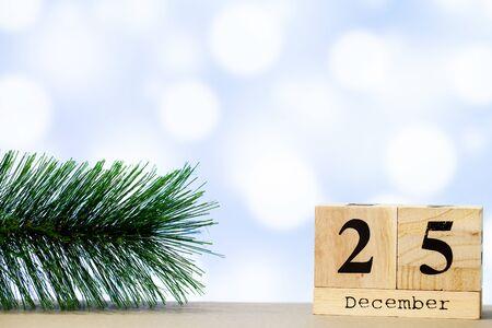 25 december and christmas decoration on blue background Reklamní fotografie