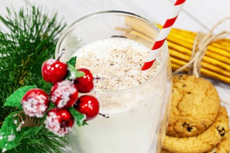 Composition with Christmas cookies and milk on white background Reklamní fotografie