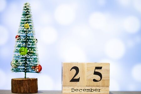 25 december and christmas decoration on blue background Stock Photo