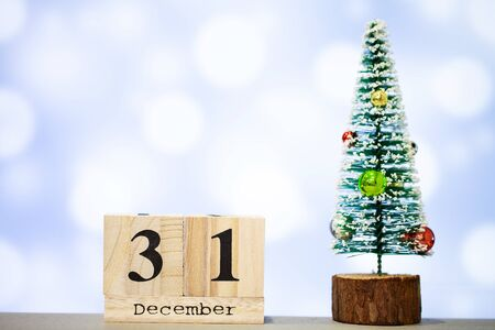 31 december and christmas decoration on blue background