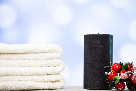 Christmas decoration and candle on blue background