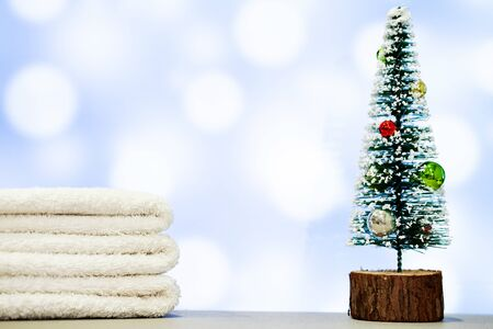 Christmas decoration and spa towels on blue background