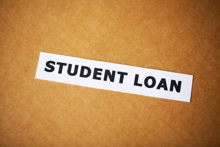 Credit concept. Student loan written on white card