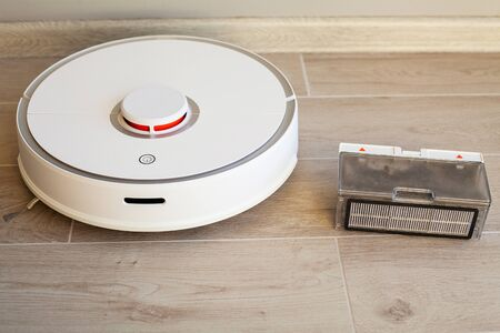 Robot vacuum cleaner performs automatic cleaning of the apartment at a certain time. Smart home