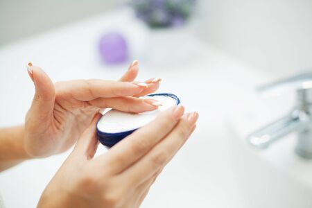 Hand Skin Care. Close Up Of Female Hands Holding Cream